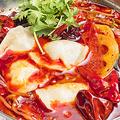 料理メニュー写真ラム肉の水餃子 スパイス鍋