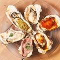 料理メニュー写真焼き牡蠣6種盛合せ