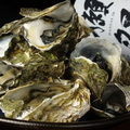 料理メニュー写真マルえもんの焼き牡蠣(4個)
