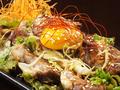 料理メニュー写真豚サガリの葱味噌焼き~卵黄のせ~