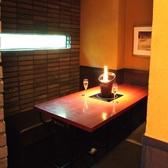 入口真横にある暖簾で区切られた半個室席