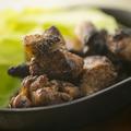 料理メニュー写真地鶏もも肉炙り焼