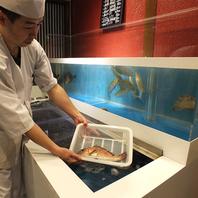 店内で泳いでいるお魚をその場で捌く!