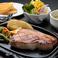 料理メニュー写真キビまる豚ロースステーキ(200g)