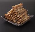 料理メニュー写真本格炭火焼の博多とりかわまき串(味は5種類)