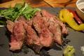 料理メニュー写真人気NO2!!希少赤毛和牛のグリル自家製ソース、わさび岩塩がうまい希少な和牛を食べてみてください。