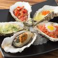 料理メニュー写真焼き牡蠣全種盛り合わせ