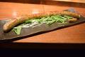料理メニュー写真人気NO3!!生ロングソーセージ45cmのロングソーセージ熱々肉汁たっぷりやけどに注意しながらどうぞ