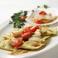 料理メニュー写真白身魚を詰めたラヴィオリ、帆立貝ソース仕立て
