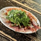 魚介のカルパッチョ:市場の目利きが選ぶ新鮮な魚介をご用意しております。