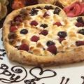 料理メニュー写真バナナとチョコと焼きマシュマロのドルチェピッツァ