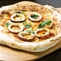 料理メニュー写真スルメイカのピザ