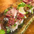 料理メニュー写真炙り牛の寿司ロール