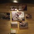 店内には生産者などの写真を展示してます。