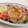 料理メニュー写真鶏もも肉の香草グリル焼き