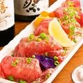 料理メニュー写真炙り肉寿司 1貫
