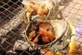 料理メニュー写真サザエの炭火焼燻製仕立て(醤油/エスカルゴ風)