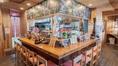 沖縄県名護市にある真やんばる酒場 照らす家。名護十字路の角に店を構える沖縄創作料理の居酒屋。