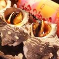 料理メニュー写真サザエのつぼ焼き (1個)