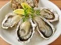 料理メニュー写真生牡蠣・焼き牡蠣(1皿2個)