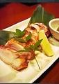 料理メニュー写真津軽鶏のもも肉焼き(柚子胡椒添え)