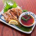 料理メニュー写真薩摩地鶏ももタタキ焼き(ポン酢和え)