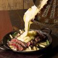 料理メニュー写真黒牛の赤身ステーキ トリュフマッシュルームソース