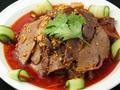 料理メニュー写真蒸し鶏の冷菜葱ソース掛け/四川風牛肉と牛雑の冷菜