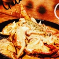 料理メニュー写真岡山備中高原産 骨付き鶏のグリル ~キノコクリームソース~