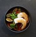 料理メニュー写真エビとアサリの魚介トマトスープ