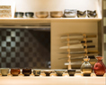"""当店に存在する食器、酒器はすべて特注のもの。食器は料理長自ら九州の窯元まで出向き、形や色や焼きまで""""料理に合わせて""""オーダーして作り上げました。酒器も多種多様な日本酒の、それぞれのもつ美味しさを最大限に引き出すよう、様々な種類のものをご用意しております"""