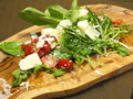 料理メニュー写真ルッコラとパルミジャーノのサラダ