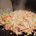 料理メニュー写真焼きシャブで出た豚の脂ででもんじゃにコクが♪