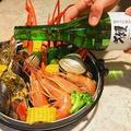 料理メニュー写真贅沢!獺祭入り海鮮宝箱蒸し