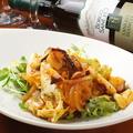 料理メニュー写真トマトソースをベースにした大好評!食べるラー油を使った《蛸キムチ》