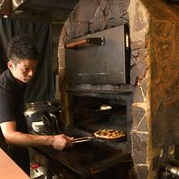 石窯で焼き上げる京野菜や、特選ピザ