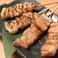 鶏皮串 2本/豚バラ 2本 (博多)
