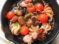 料理メニュー写真イイダコとトマトのアヒージョ