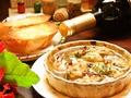 料理メニュー写真人気NO.1広島産カキのガーリックオイル煮