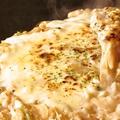 料理メニュー写真豆腐とキムチの韓流チゲもんじゃ/豚もちチーズもんじゃ