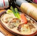 料理メニュー写真●ブーレッテンのチーズクリームグリル(ドイツのハンバーグ)
