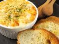 料理メニュー写真蟹の蟹味噌による蟹グラタン