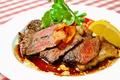 料理メニュー写真霜降高原牛のサーロインステーキ(200)g バルサミコソース