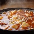 料理メニュー写真鉄鍋マーボー豆腐(大人気!)