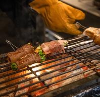 炭火で焼く福岡名物「野菜肉巻き」