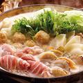 料理メニュー写真具だくさん深谷ねぎに帆立たっぷりの塩ちゃんこ鍋