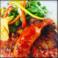 料理メニュー写真【鶏もも肉と骨付きフランクフルト~スパイシートマトソース~】