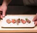 料理メニュー写真マグロの生ハム 季節の野菜を添えて