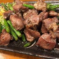 国産豚カシラ肉とニンニクの芽炒め