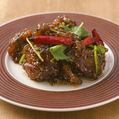 料理メニュー写真鶏もも肉の唐揚げ ピリ辛山椒風味